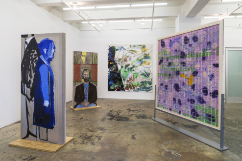 models stand close to the paintings - Installation view: south wall