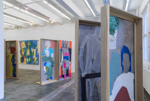 models stand close to the paintings - Installation view: south and west walls