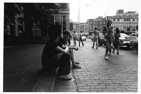 Adrian Piper – The Mythic Being, 1972-1975 - Adrian Piper Cruising White Women #2, 1975. B/W photo documentation of a street performance in Cambridge, MA, 10 x 8 in.