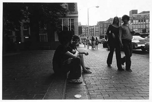 Adrian Piper – The Mythic Being, 1972-1975 - Adrian Piper Cruising White Women #3, 1975. B/W photo documentation of a street performance in Cambridge, MA, 10 x 8 in.