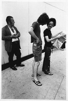 Adrian Piper – The Mythic Being, 1972-1975 - Adrian Piper Getting Back #1, July 1975. B/W photo documentation of a street performance in Cambridge, MA, 10 x 8 in.