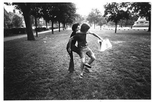 Adrian Piper – The Mythic Being, 1972-1975 - Adrian Piper Getting Back #3, July 1975. B/W photo documentation of a street performance in Cambridge, MA, 10 x 8 in.
