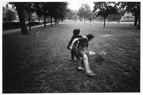 Adrian Piper – The Mythic Being, 1972-1975 - Adrian Piper Getting Back #4, July 1975. B/W photo documentation of a street performance in Cambridge, MA, 10 x 8 in.