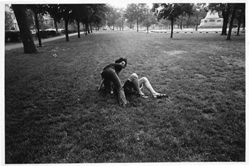 Adrian Piper – The Mythic Being, 1972-1975 - Adrian Piper Getting Back #5, July 1975. B/W photo documentation of a street performance in Cambridge, MA, 10 x 8 in.