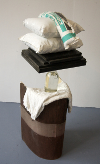QuietlyLoud – Natasha Conway, Alisha Kerlin, Cassie Raihl - Cassie Raihl, WaterStack, 2010. Wood, plaster, vase, water, plastic, stuffing. 16 x 45 x 13 in.