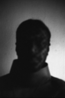 PAT – Unseen, unheard, unexplained - PAT Untitled (Man in Mask, 2), 2007. Gelatin silver print, 19.5 x 13 in (image size), ed. of 7.