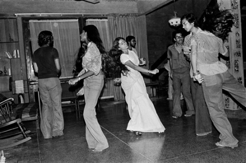 Pablo Bartholomew – Outside In - Nommie Dancing at a Party at Koko's, New Delhi, 1975. Gelatin silver print, edition of 10 (+3 AP), 16 x 24 in.
