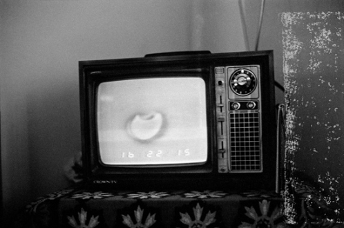 Pablo Bartholomew – Outside In - Solar Eclipse on TV, 1979. Gelatin silver print, edition of 10 (+3 AP), 16 x 24 in.