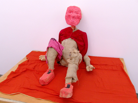 Roza-El-Hassan - Red Man, 2006. Wood, fabric and mixed media, 33 x 34 x 43 in.