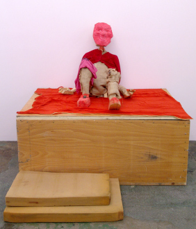 Roza-El-Hassan - Red Man, 2006. Wood, fabric and mixed media, 33 x 34 x 43 in. (installation view)