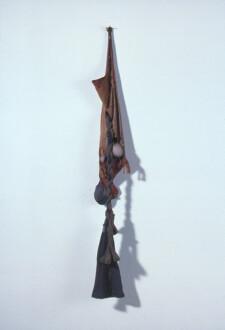 Nylon Mesh - <i>Sagging</i>, winter 1977 (original piece/documentation) Nylon mesh, sand and leather, 4 x 1.5 feet. Collection of Ms. Gylbert Coker.