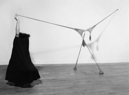 Performance Photographs - <I>Studio performance with 'R.S.V.P'</i> 1976. Silver gelatin print, 30 x 40 in, edition of 5 (+1 AP). Nylon mesh (pantyhose), sand, dried rose petals, and full length wool skirt Slauson Boulevard, Los Angeles Photo: Ken Peterson