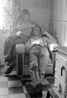 Tom Wood – Men and Women - Charlie and Alan in Granny's chair, 1977. Silver gelatin print, edition