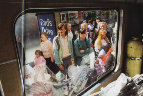 Tom Wood – The Bus Project - Strand Shopping Centre - Bootle, 1989. C-print, 12 x 18.5 in, edition of 6 (+1 AP).