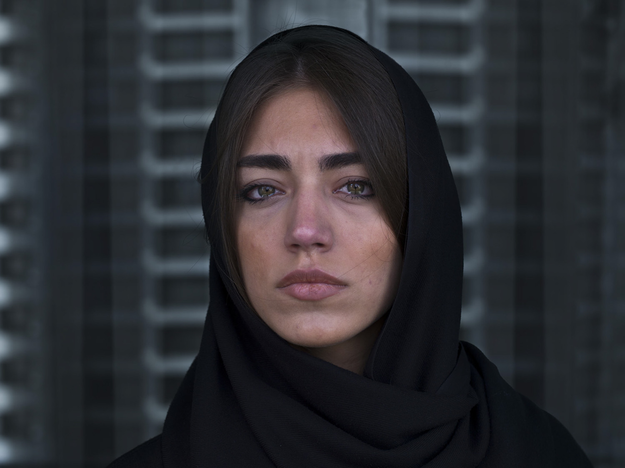 """Thomas Erben Gallery – 25 years - Newsha Tavakolian, <i>Look (portrait)</i>, 2012/13. Inkjet print, edition of 7 (+2 AP), 41 x 55 in. <br></<br><br></<br> This photograph by Newsha Tavakolian was part of <i>Look</i>, her first US solo exhibition in 2013. Over the years - parallel to her career as a photojournalist, publishing in such venues as <i>Time</i>, <i>Newsweek</i>, <i>Stern</i>, <i>Le Figaro</i>, <i>The New York Times</i>, <i>Der Spiegel</i>, Le Monde</i>, and <i>National Geographic</i> - Tavakolian has developed projects focusing on women's rights and other social issues. Since 2019 she is a full member of Magnum Photo. <br></<br><br></<br> Regarding this body of work, she wrote:<br></<br> """"<i>Look</i> began with my desire to look deeply into the lives of people around me whom I have known for over ten years, and who live in my building. I wanted to bring to life the story of a nation of middle-class youths who are constantly battling with themselves, their isolated conformed society, their lack of hope for the future and each of their individual stories. Over a period of six months, at 8 pm, I fixed my camera on a tripod in front of the window where I had watched the same view of the city for ten years. I tried to capture a moment of each of their stories, within the frame of a window looking out onto the cold concrete buildings which surround us daily."""""""